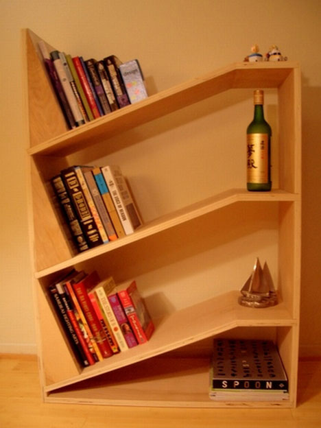 angled bookshelfleave it to a former aeronautical engineer to come up with this chic and handy twist on a common bookshelfthe slanted shelves render - Funky Bookshelves