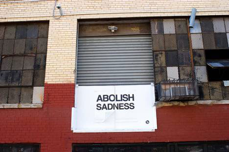 guerrilla art abolish sadness