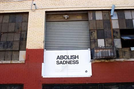 guerrilla art abolish sadness