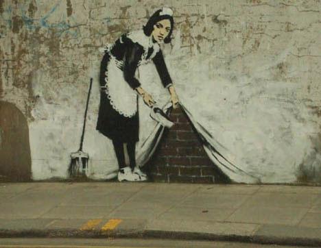 guerrilla art banksy maid sweep