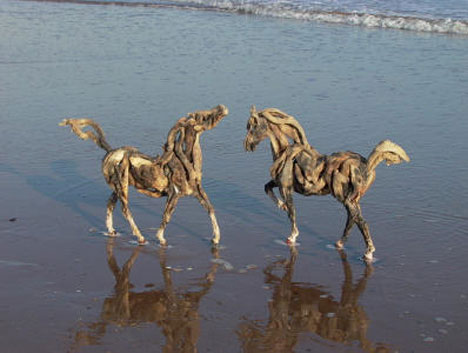 Two driftwood horses on the beach urbanist the weathered wood that composes these horses may look delicate but the sculptures are reinforced to keep them strong the artist takes great care in not publicscrutiny Gallery
