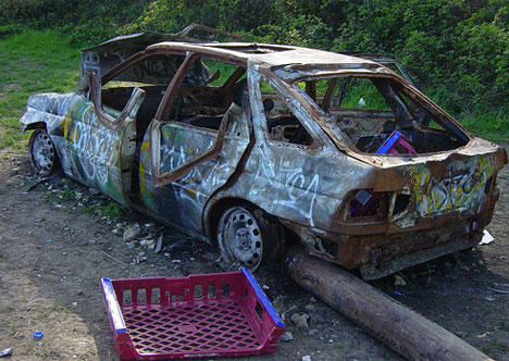 abandoned burned out car