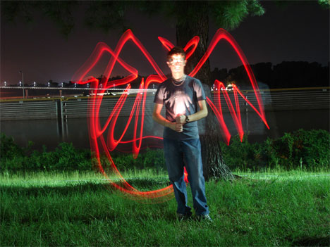 time lapse photography light graffiti devil