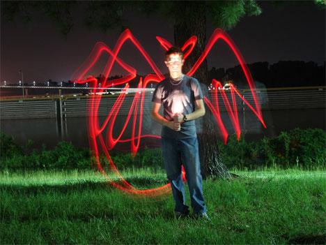time lapse photography light graffiti devil