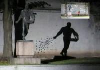 Statue Seeding Shadows by Night