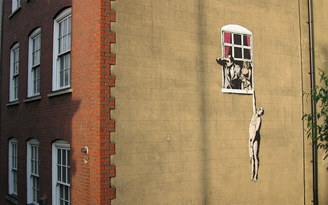 banksy bristol man hanging out of window