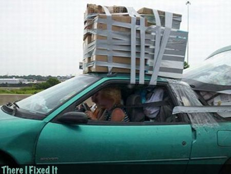 box duct taped to roof of car