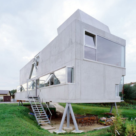 Concrete House on Stilts in Austria Has a Surprising Interior