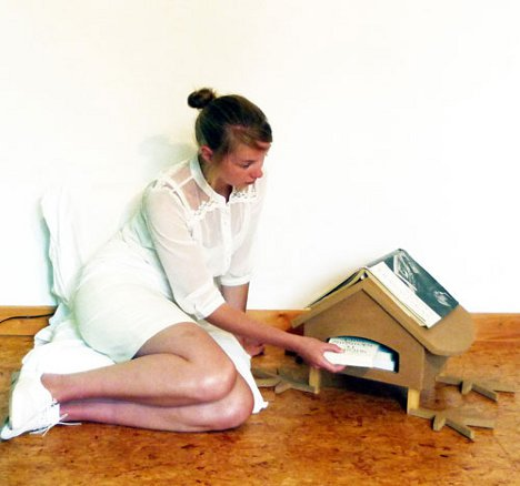 for book lovers the lay on is a sweet little house that helps organize your reading the slot in front holds a small number of books while in progress accessoriesendearing lay small