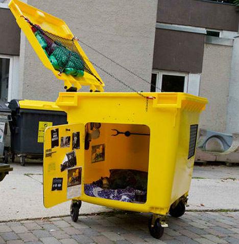 Dystopian Dumpster Living: Trash Bins Turned Tiny Houses