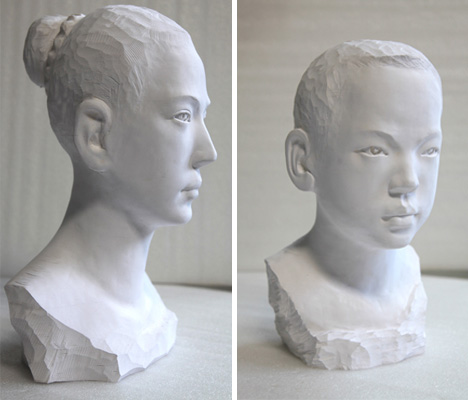 girl and boy paper sculptures