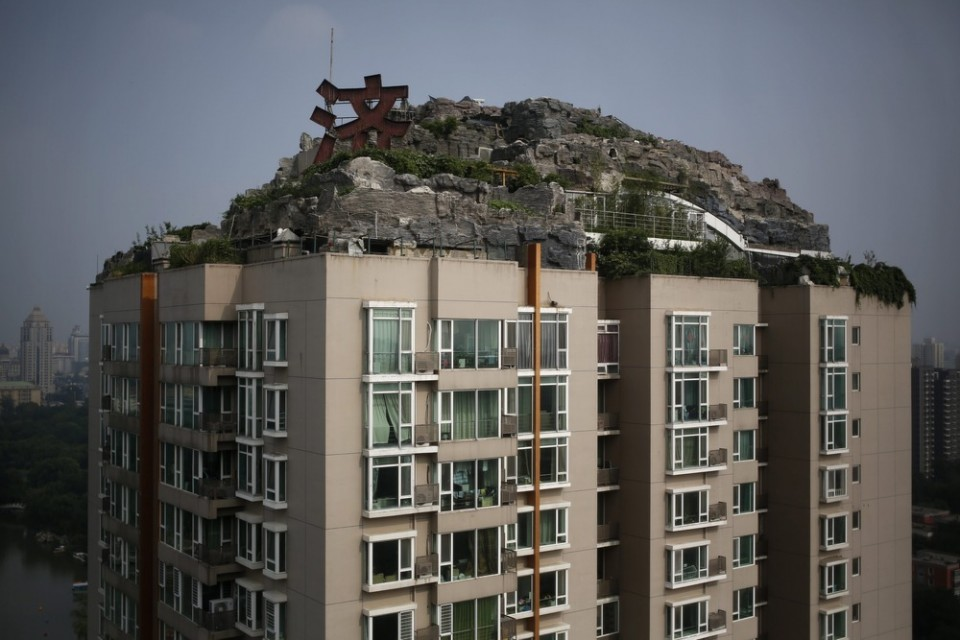 Image: A villa built privately on the rooftop of a 26-storey residential block in Beijing.