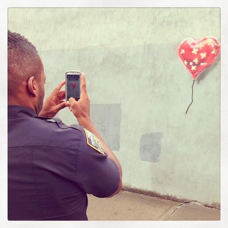 banksy police heart photo