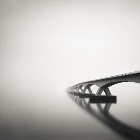 black white bridge fog