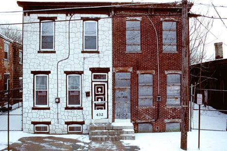 half townhouse disrepair repainted