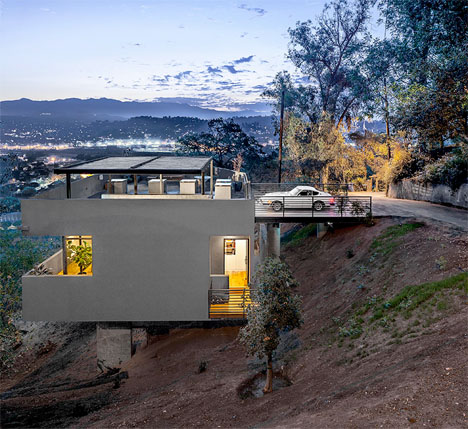 House In Reverse Rooftop Driveway Leads To Hillside Home furthermore Brick Houses additionally Radical Remodel Warehouse To Home Renovation Project furthermore X Shaped House Hangs Over Hillside In Barcelona additionally Thing. on urban home design ideas