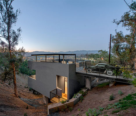 House In Reverse Rooftop Driveway Leads To Hillside Home