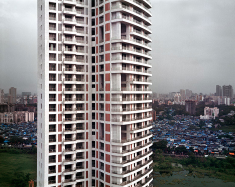 scryscraper slum backdrop mumbai
