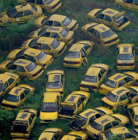 abandoned yellow taxi cabs Chongqing China