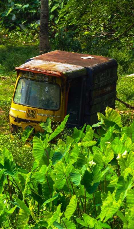 abandoned tuk-tuk taxi cab Kannur India