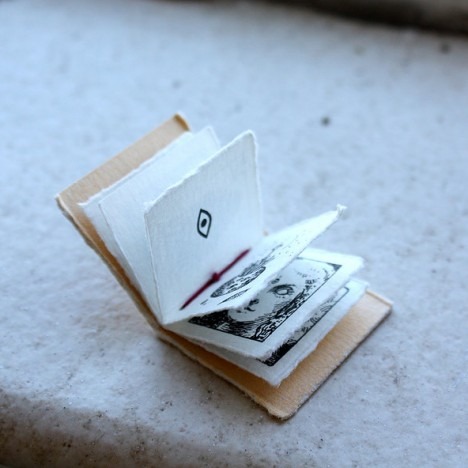 tiny book folded open