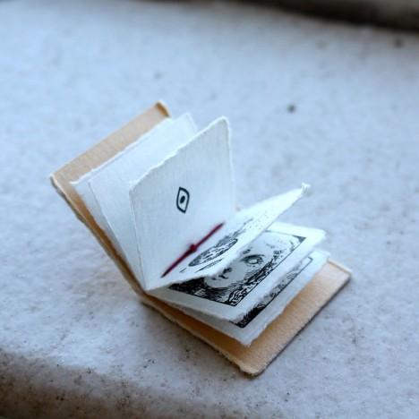 tiny book folded open