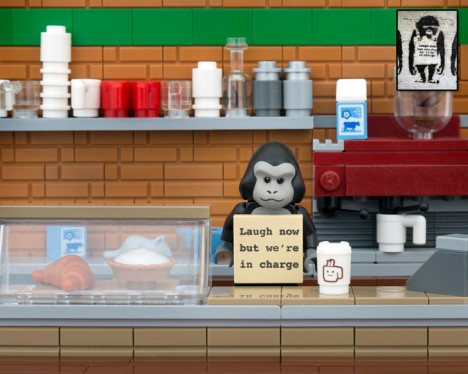 """Banksy monkey: """"Laugh Now But We're In Charge."""""""