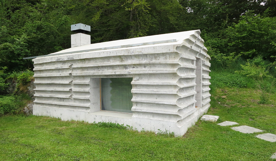 Fossilized retreat log cabin remnants recast in concrete for Concrete log cabins