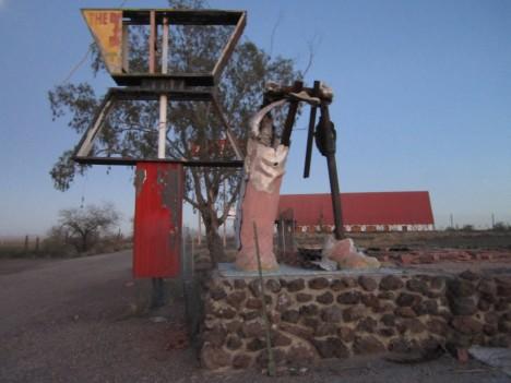 Picacho Trading Post Indian statue AZ fire legs Ozymandias
