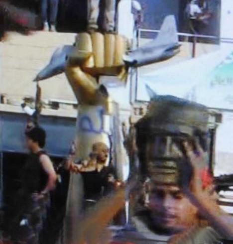 smashed statue Gaddafi Libya