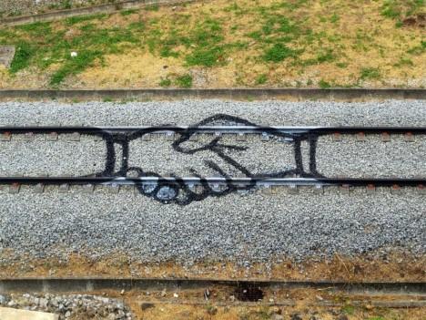 train painting hand shake