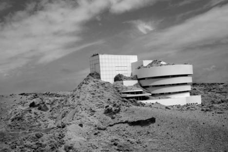 guggenheim half buried sand