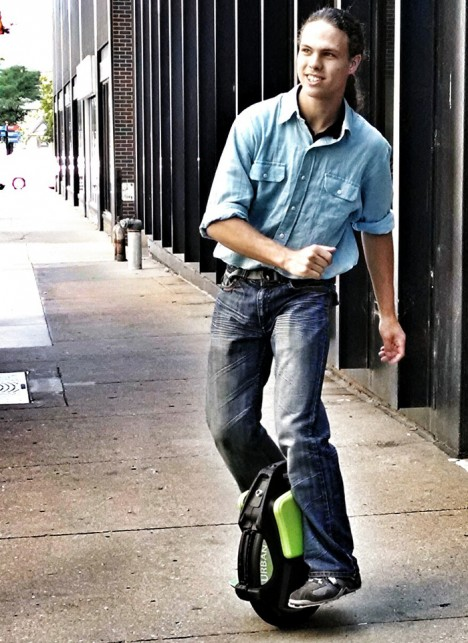 unicycle city street sidewalk