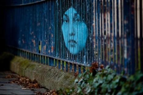 subtle street art lenticular fence 1