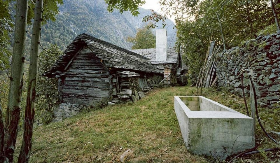 Rustic swiss structure hides modern underground home for Homes for sale with hidden rooms