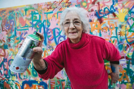 elderly spray paint woman