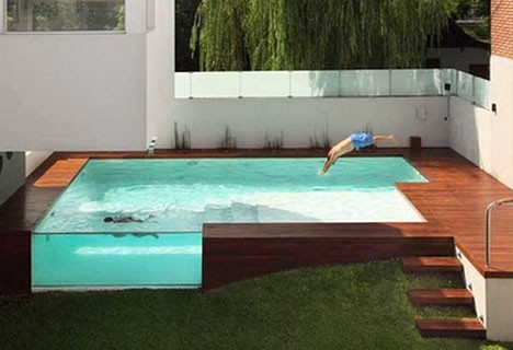 modern pool glass walled wooden deck