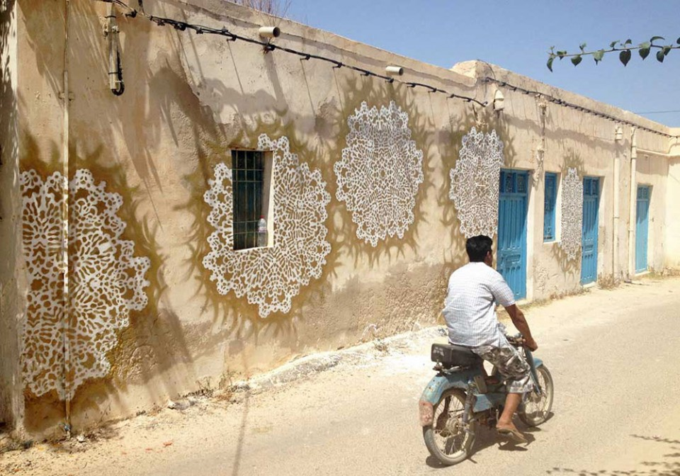 spray painted doilies on concrete