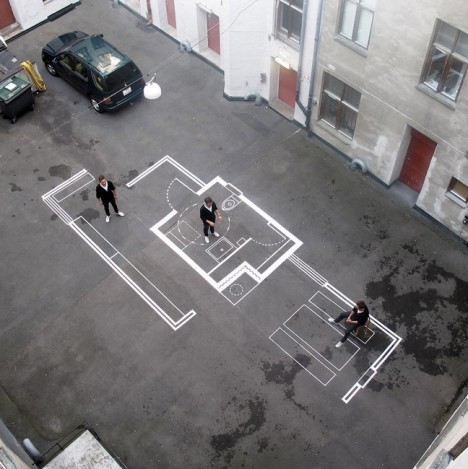 Drawn up architecture firm uses tape for full scale floor for Architecture firms