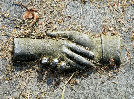 grave symbolism clasped hands