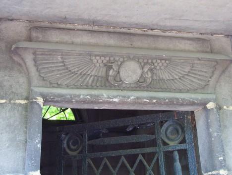 grave symbolism sun disc