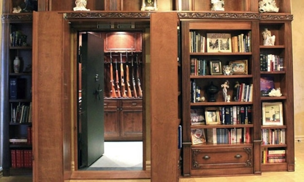 Hiding in plain sight 17 secret spaces from safes to pubs for Walk in gun safe plans