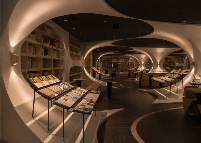 Tunnel Of Books Shelves Wrap Curved Bookstore Walls