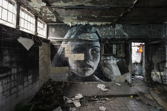 beauty in decay moody murals bring human faces back to abandoned