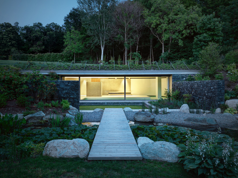 sort of subterranean 15 partially underground modern home