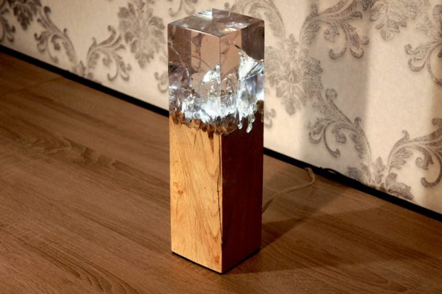 Smashed chunks of wood are not only made whole again with the addition of  tinted resin, but also transformed into lamps thanks to embedded LED bulbs.