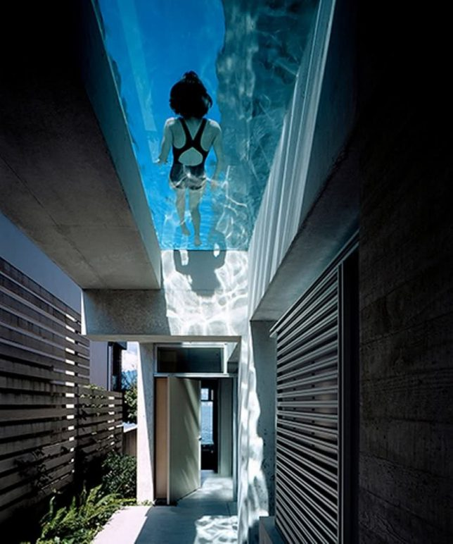 The glass floored swimming pool of the shaw house by patkau architects hangs off the side of the second level like a watery balcony casting its shimmering
