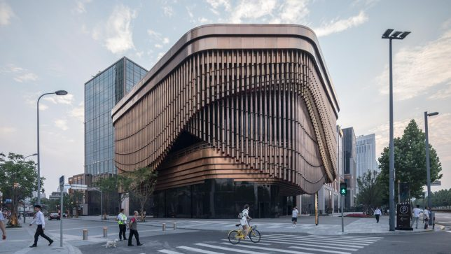 It Was Inspired By Chinese Theaters With Bamboo Like Bronze Tubes Set In Three Layers Around The Perimeter Constituting What Designers Describe As A