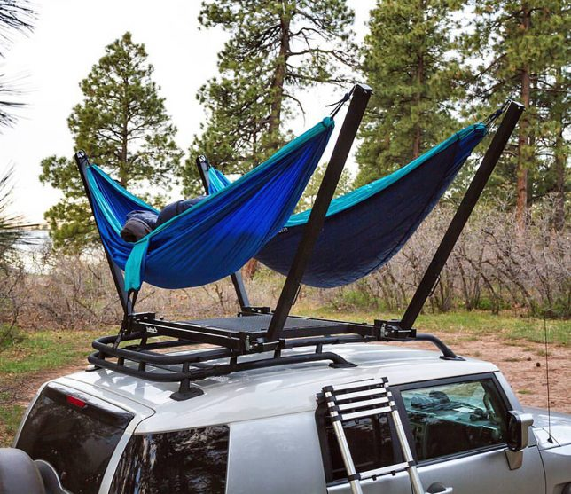 anywhere your vehicle can take you with the trailnest a simple hammock stand that clamps onto your roof rack in a one person or two person setup  hang loose  13 hammock innovations for max relaxation   urbanist  rh   weburbanist