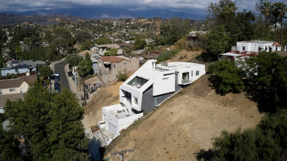 Sliced And Folded Modern White House Tumbles Down A Hill In Los